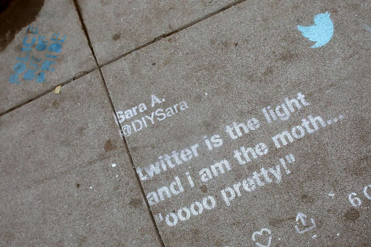 FILE - Twitter tweet drawn in chalk on a sidewalk on Taylor St. between Turk and Eddy streets seen on Thursday, Sept. 12, 2019 in San Francisco, Calif. Twitter also faced some heat for stenciling some tweets onto the sidewalk as part of a marketing campaign.