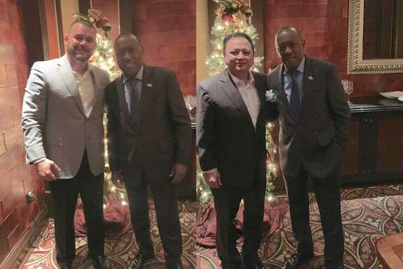 A composite of two images of Prime Social Poker Club co-owners Brandon Jimenez, left, and David Nguyen pose with Houston Mayor Sylvester Turner at a Dec. 18, 2018 meeting where they say they presented the club's business model. Turner repeatedly said he has no recollection of such a meeting.