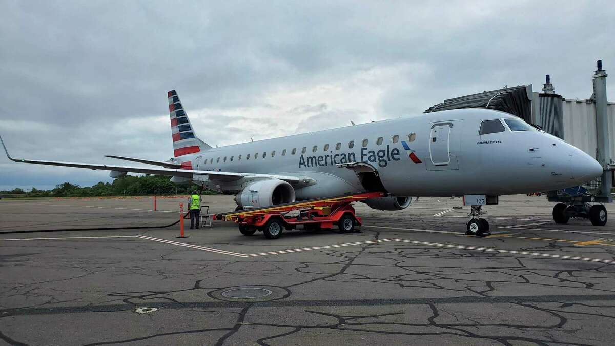An American Eagle Embraer E175 regional jet, just arrived from Philadelphia, parked on the tarmac at Tweed New Haven Regional Airport in September 2019.