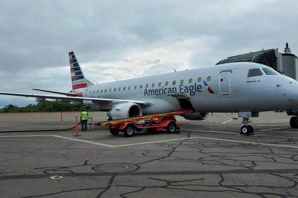 An American Eagle Embraer E175 regional jet, just arrived from Philadelphia, parked on the tarmac at Tweed New Haven Regional Airport Sept. 12, 2019. American recently upgraded to the 76-seat planes, which bring First Class service back to Tweed for the first time since 1995.