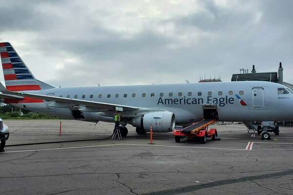 An American Eagle Embraer E175 regional jet, just arrived from Philadelphia, parked on the tarmac at Tweed New Haven Regional Airport.on Thursday afternoon, Sept. 12, 2019. American recently upgraded to the 76-seat planes, which bring First Class service back to Tweed for the first time since 1995.