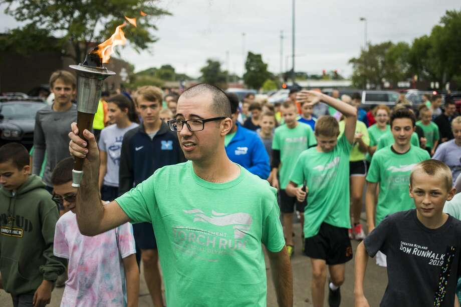 Jameson Baker carries the torch as the Law Enforcement Torch Run kicks off Thursday, Sept. 12, 2019 at the Midland Law Enforcement Center. (Katy Kildee/kkildee@mdn.net) Photo: (Katy Kildee/kkildee@mdn.net)
