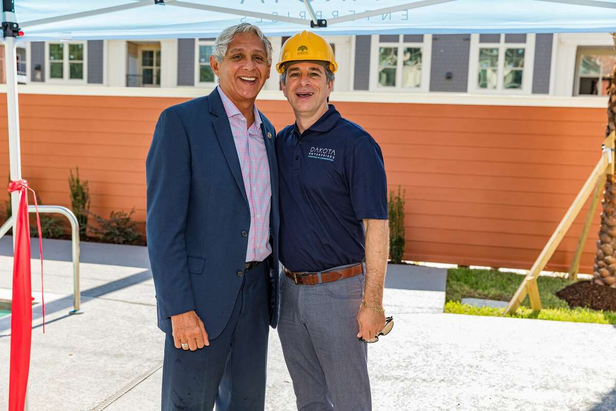 City Councilman Robert Gallegos and Dakota Enterprises CEO Rick Guttman celebrate the opening of the Magnolia Park Apartments in the Greater East End.