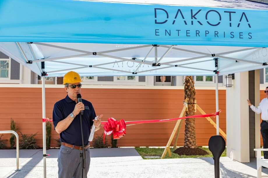 Dakota Enterprises CEO Rick Guttman marks the opening of the Magnolia Park Apartments at 7250 Avenue C on Thursday, Sept. 5, 2019. Photo: Dakota Enterprises / Trish Badger