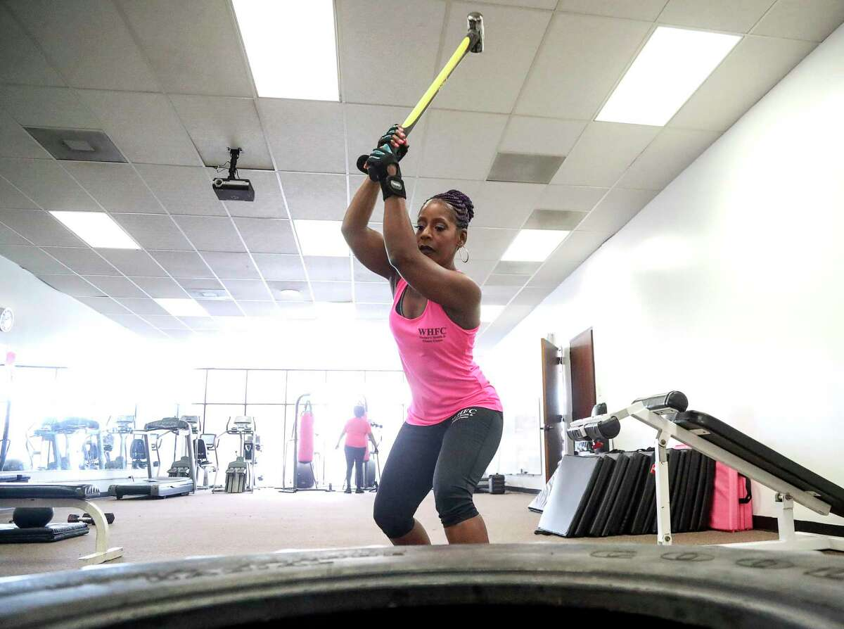 Felicia Lee-Sexton, a recovering cocaine addict and a health and wellness manager at Legacy Community Health, exercises on Thursday, July 18, 2019, in Houston.