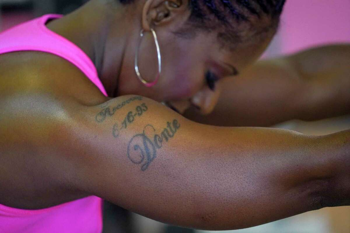 Felicia Lee-Sexton, a recovering cocaine addict and a health and wellness manager at Legacy Community Health, has a tattoo that lists parts of her recovery, including God, her