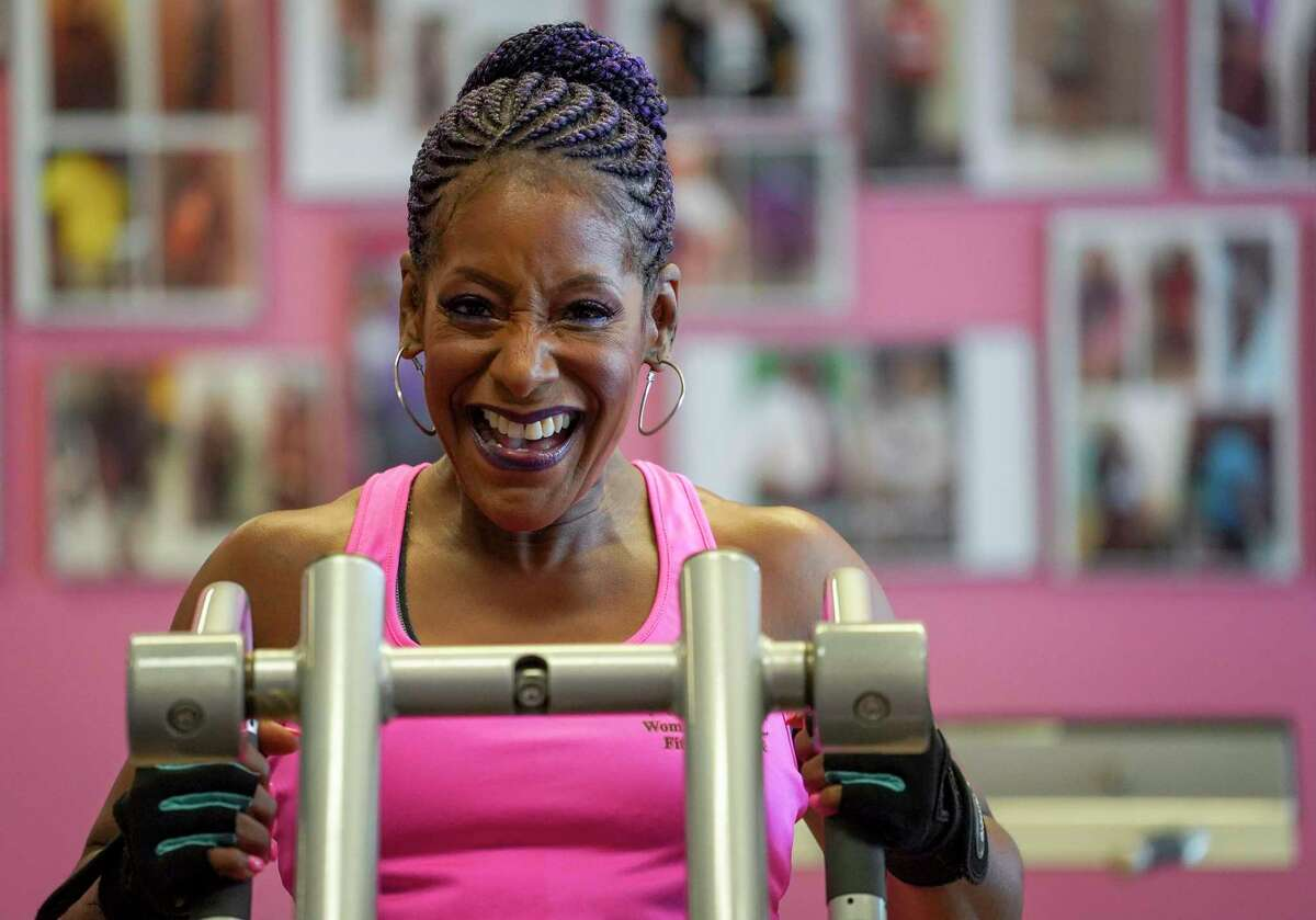 Felicia Lee-Sexton, a recovering cocaine addict and a health and wellness manager at Legacy Community Health, lifts weights on Thursday, July 18, 2019, in Houston. She said she started body building at the age of 43, and she opened a gym for women called the Women's Health and Fitness Center.