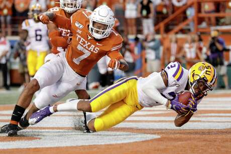 LSU's Justin Jefferson catches a touchdown pass in front of Longhorns defensive back Caden Sterns Saturday in the Tigers' 45-38 win at Darrell K Royal-Texas Memorial Stadium.