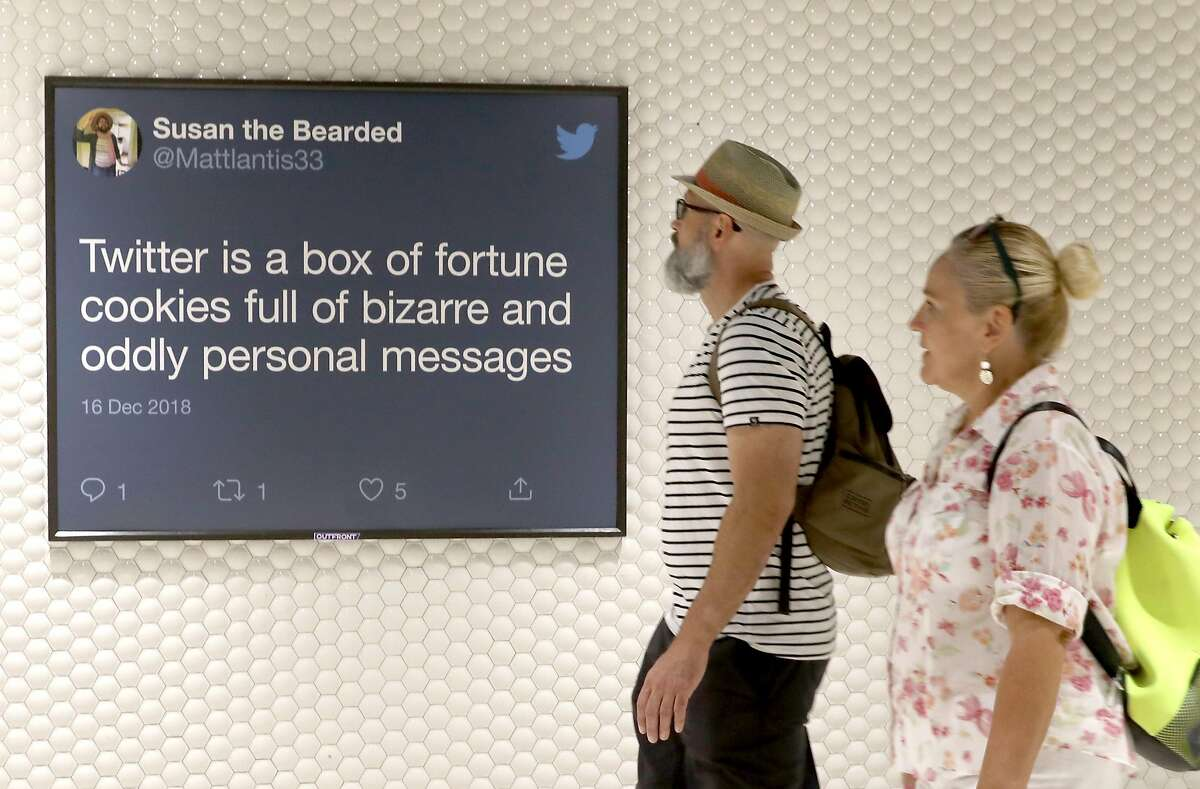 Tweets are displayed on Twitter billboard ads inside Powell Street station on Thursday, Sept. 12, 2019 in San Francisco, Calif.