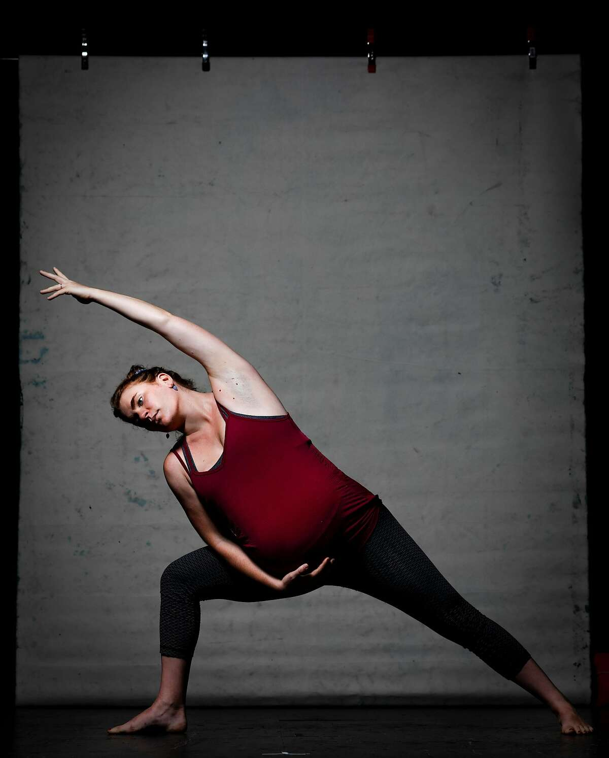 Charlotte Bruce-Byrne, who has been practicing yoga at Yoga Tree with Jane Austin, strikes the tapas arm work pose on Thursday, Sept. 12, 2019 in San Francisco, Calif.