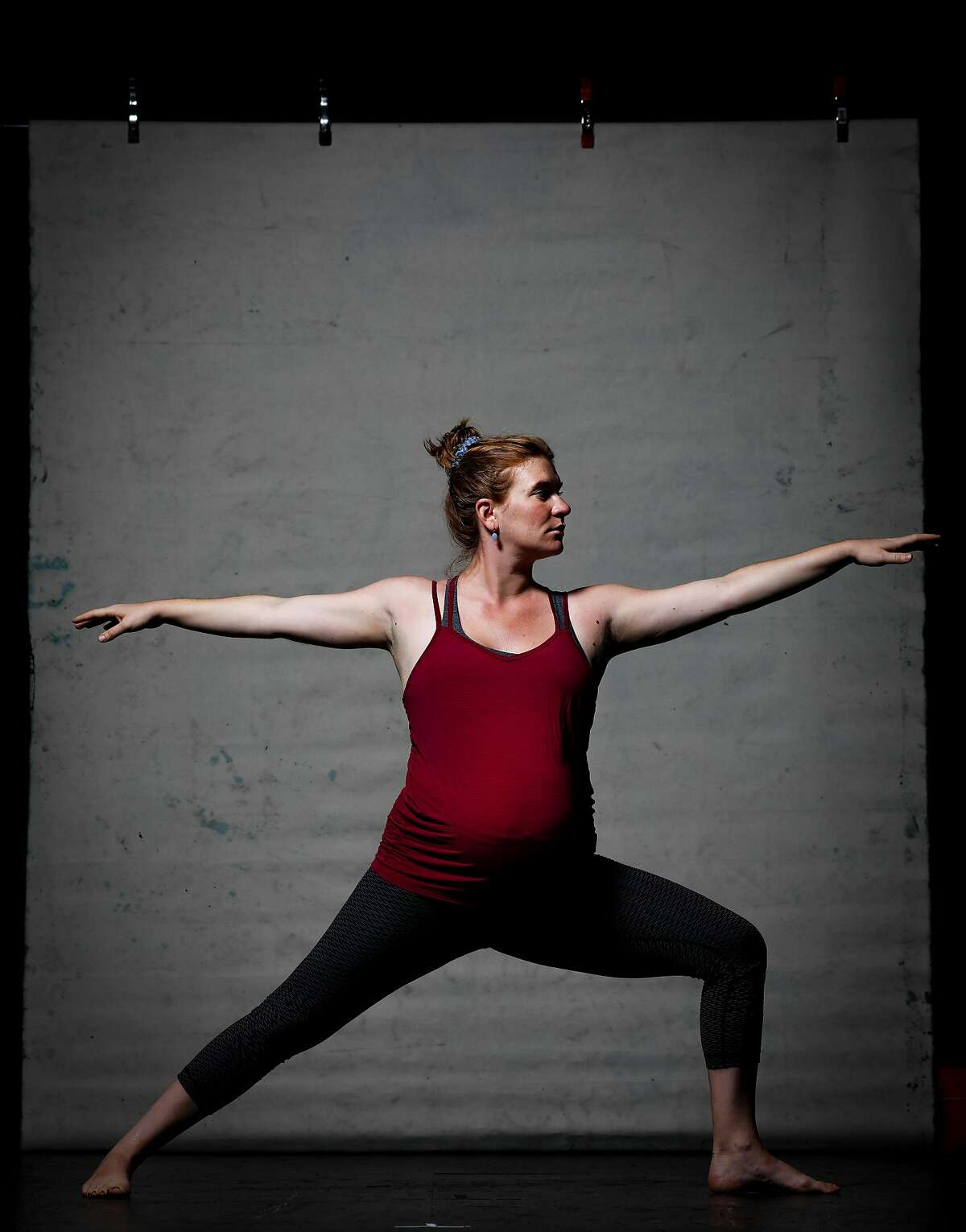 Charlotte Bruce-Byrne, who has been practicing yoga at Yoga Tree with Jane Austin, strikes the extended side angle pose on Thursday, Sept. 12, 2019 in San Francisco, Calif.