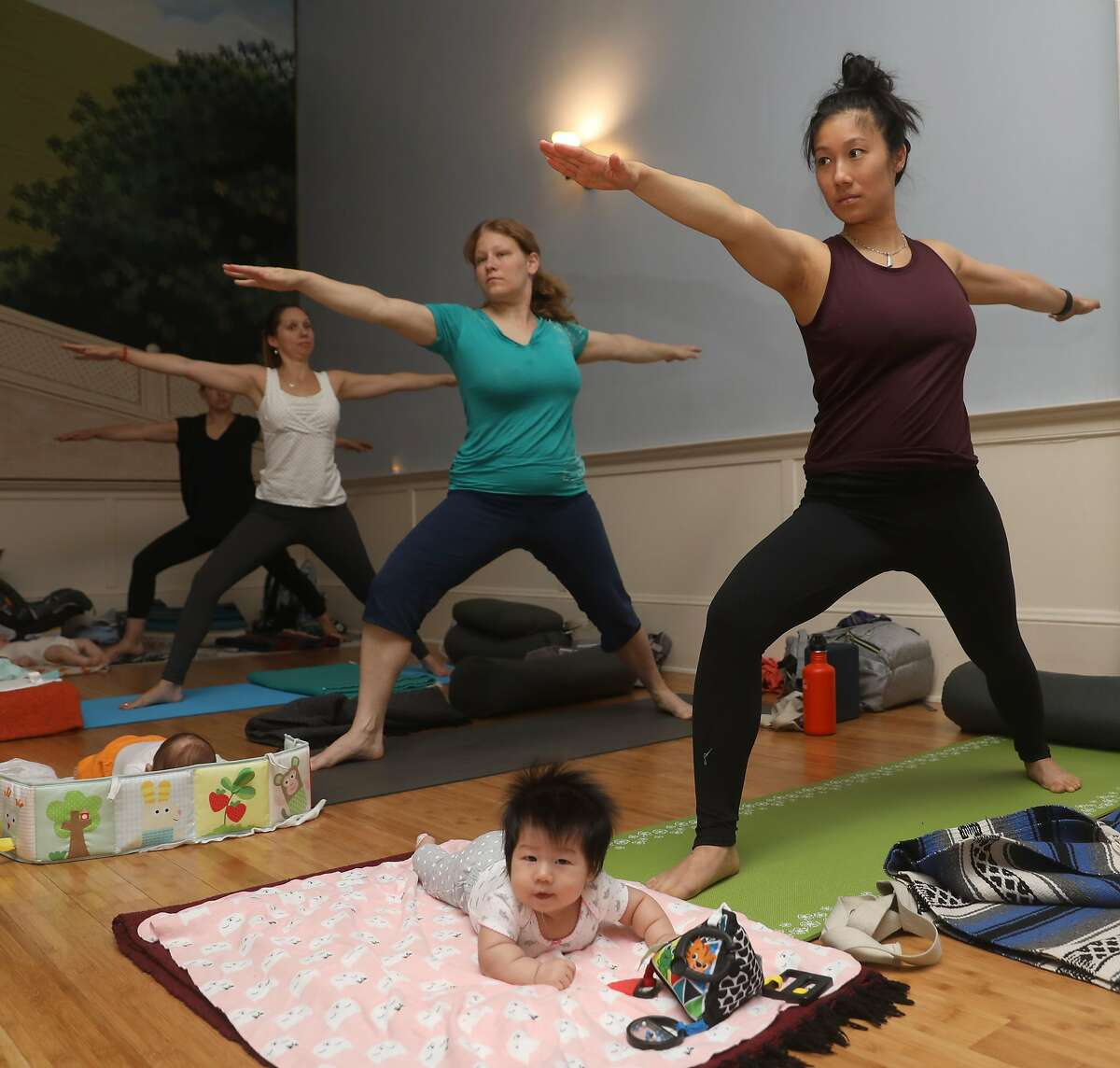 Emma (left), 12 weeks old, takes mom and baby yoga class with her mom Amanda Chau from San Francisco,at Yoga Tree on Friday, Sept. 6, 2019 in San Francisco, Calif.