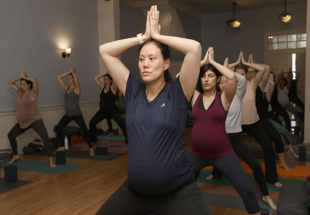 A prenatal yoga class takes place at Yoga Tree on Friday, Sept. 6, 2019 in San Francisco, Calif.