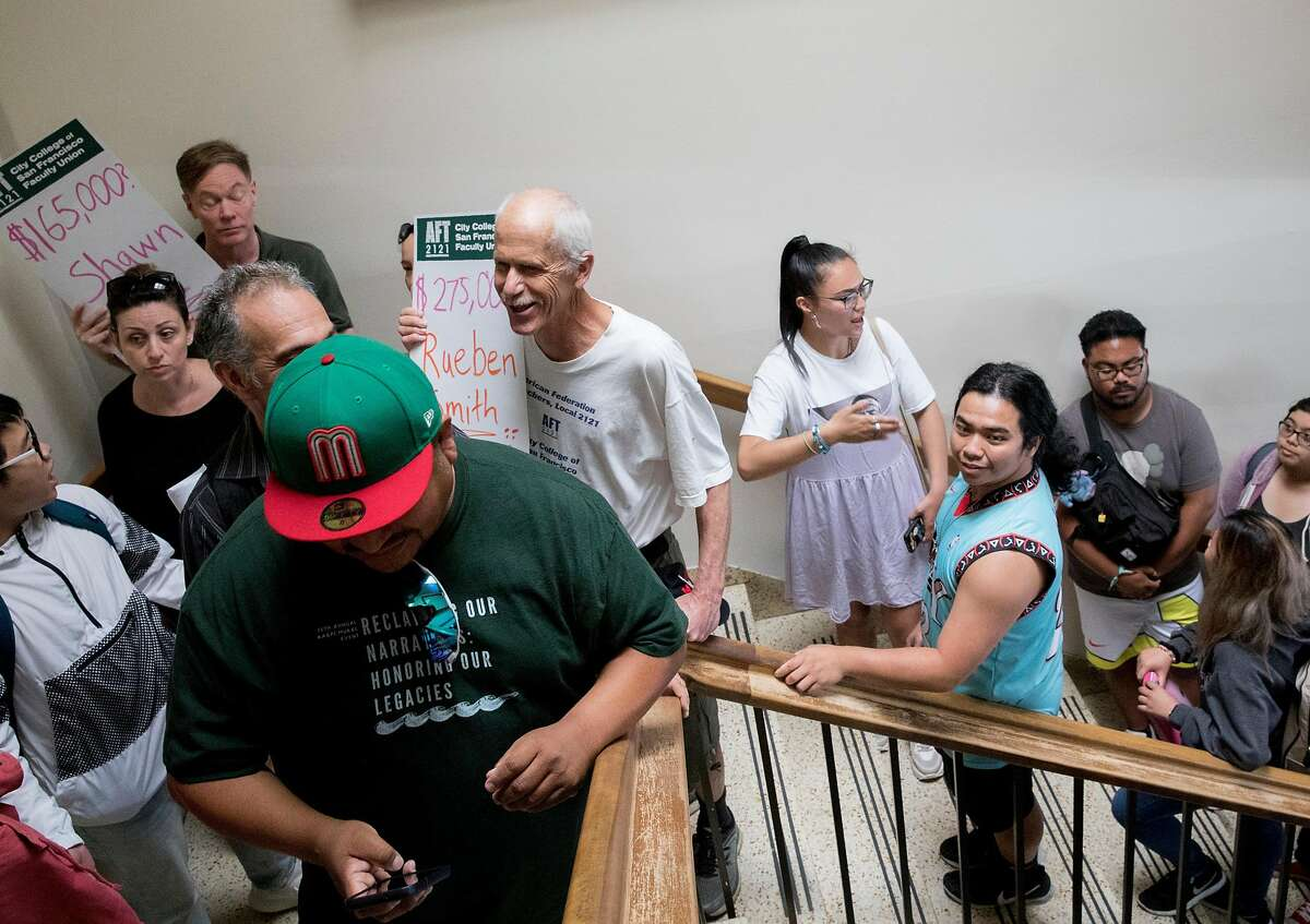 Students and faculty demonstrators ascend the staircase to Chancellor Mark Rocha's office inside Conlan Hall to protest large executive raises amidst class cuts at City College of San Francisco's Conlan Hall in San Francisco, Calif. Thursday, September 12, 2019.
