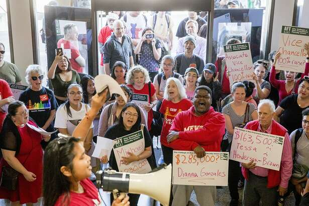 Students and faculty demonstrators chant as they gather inside Conlan Hall to protest large executive raises amidst class cuts at City College of San Francisco's Conlan Hall in San Francisco, Calif. Thursday, September 12, 2019.