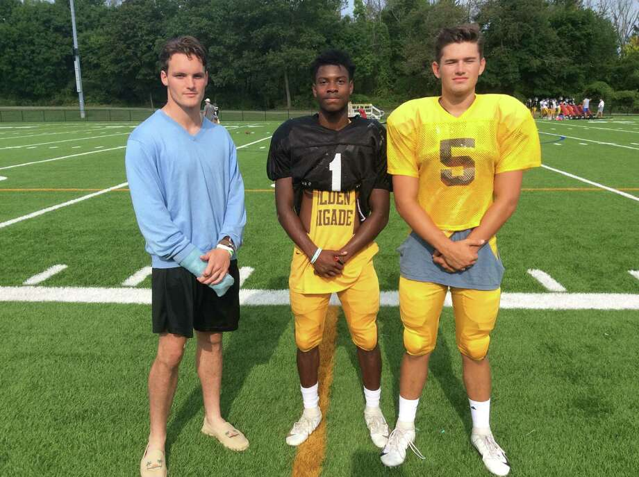 From left to right, Aengus Rosato, Kevonne Wilder and Nick Winegardner are senior captains of the Brunswick School football team. Photo: David Fierro /Hearst Connecticut Media
