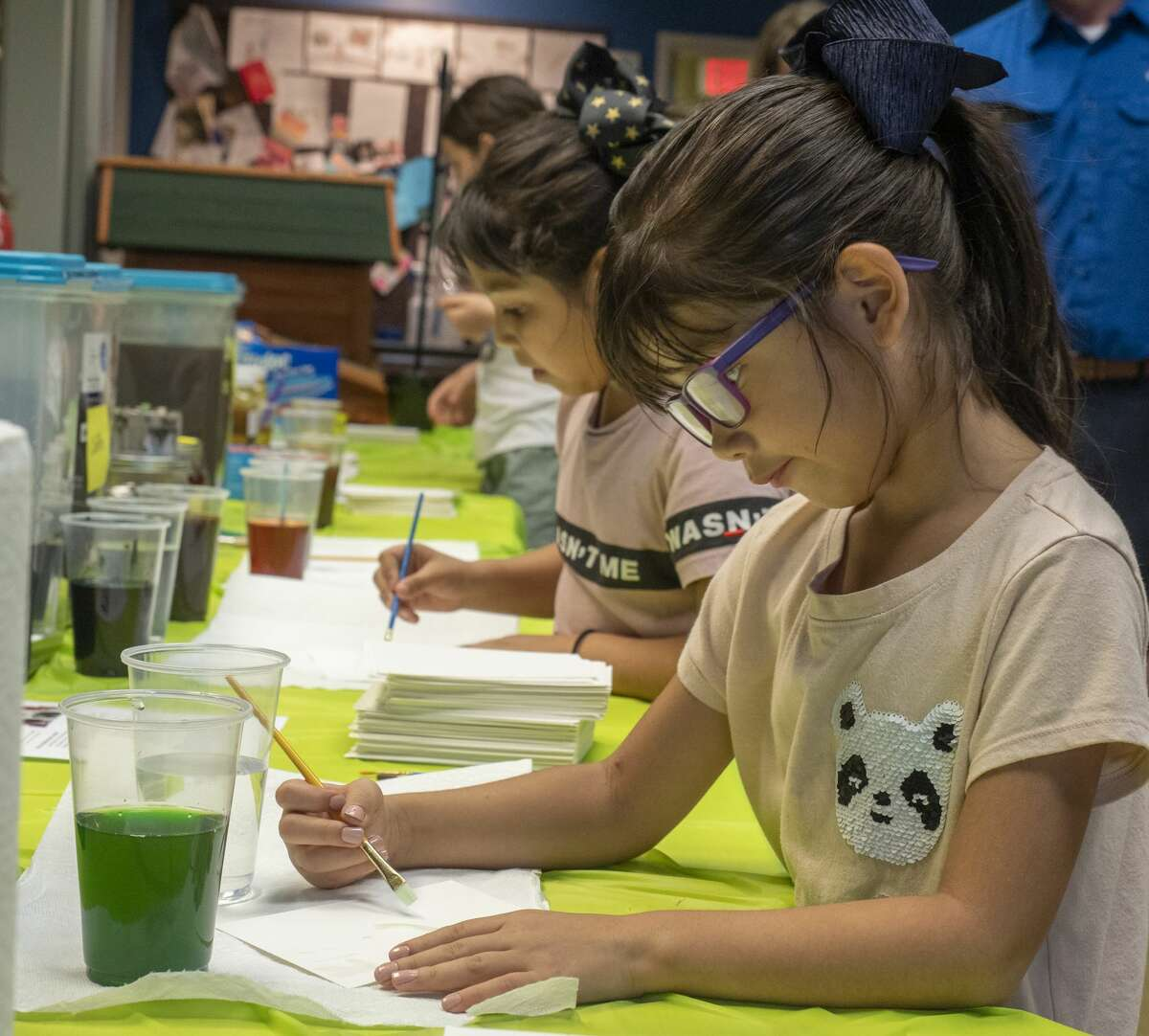 Eli Benitez and her sister Eden paint with food in this file photo from a 2019 Family Science Night at the Permian Basin Petroleum Museum. Tim Fischer/Reporter-Telegram