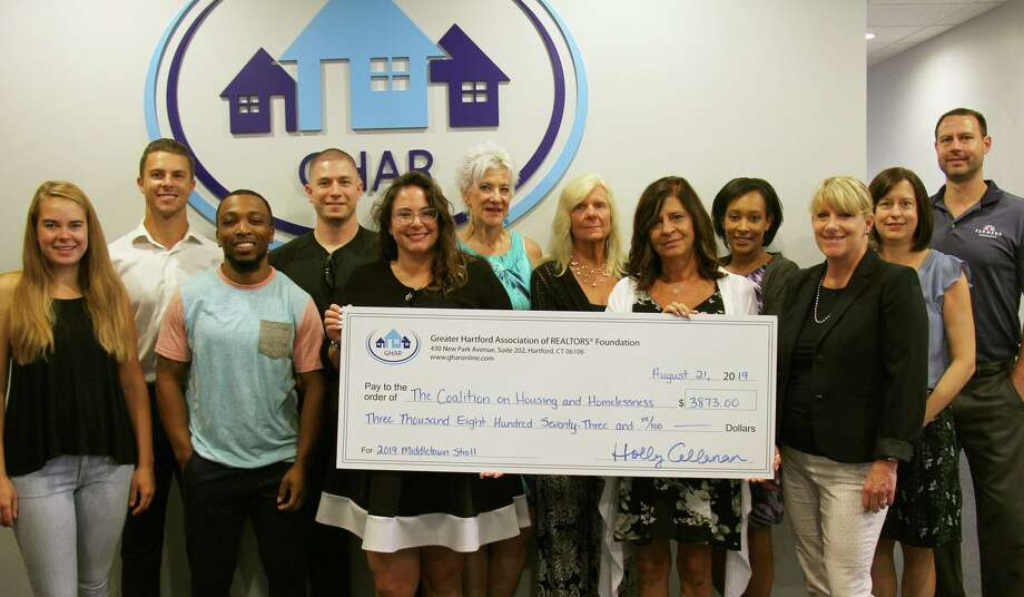 The Greater Hartford Association of Realtors held a benefit July 17 to raise funds for the Coalition on Housing and Homelessness in Middletown. From left are Sasha Torchigina, Josh Sidoti, Chevon Schand, Joe Malone, Alexa Kebalo Hughes, Mary Beth Bain, Linda Gurtel, Ellen Paklos, Rachel Johnson, GHAR CEO Holly Callanan, Coalition Executive Director Ann Faust and Brian Nokes. Photo: Contributed Photo