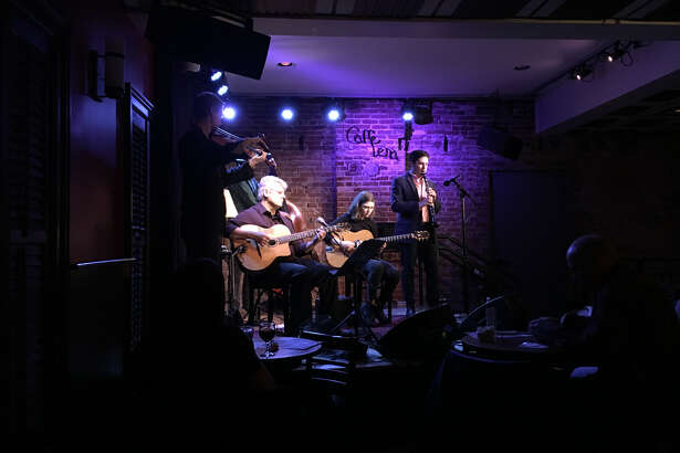 """Hot Club of Saratoga performing with previous guest guitarist Sara L'Abriola at a """"Hot Club Series"""" event at Caffe Lena in December 2018 (photo courtesy Hot Club of Saratoga)"""