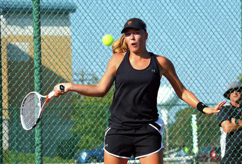 Edwardsville sophomore Hannah Colbert makes a forehand return during her No. 1 doubles match Thursday at O'Fallon.