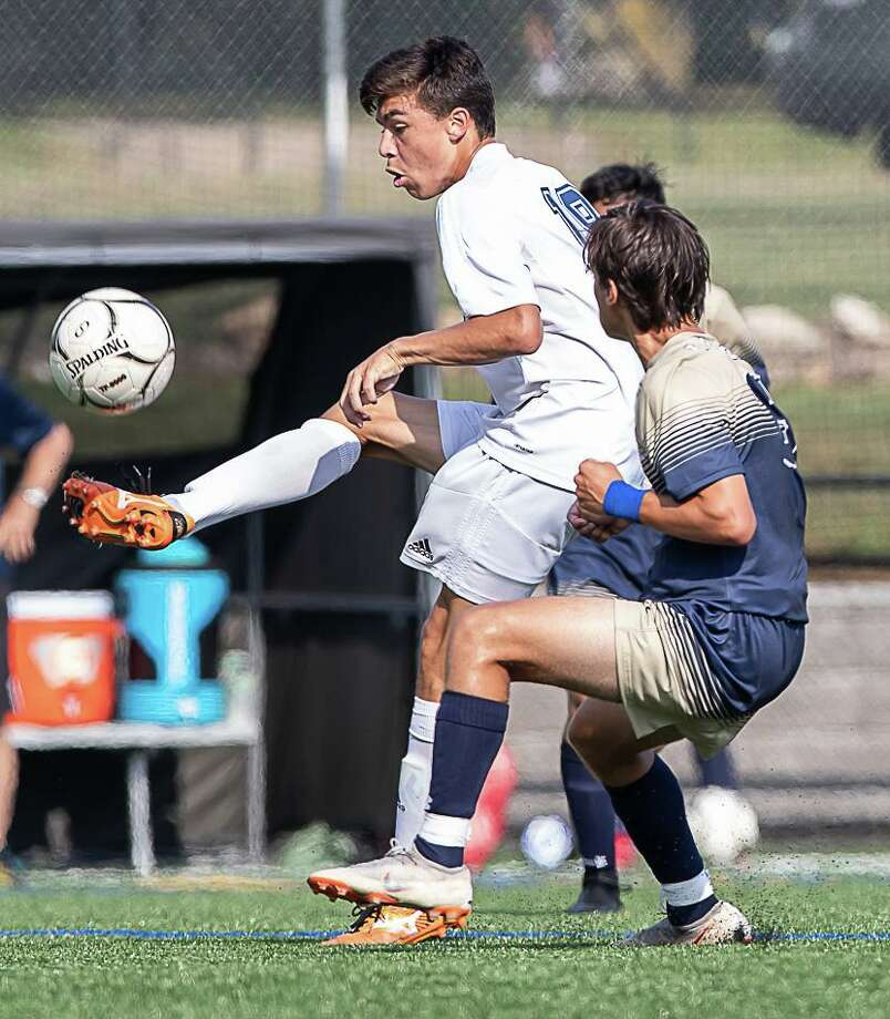 New Fairfield player Giovanni Linero works to get the ball up the field in the boys soccer match against Notre Notre Dame of Fairfield High School in Fairfield on Sept. 6, 2018. Photo: John McCreary / For Hearst Connecticut Media / Connecticut Post Freelance