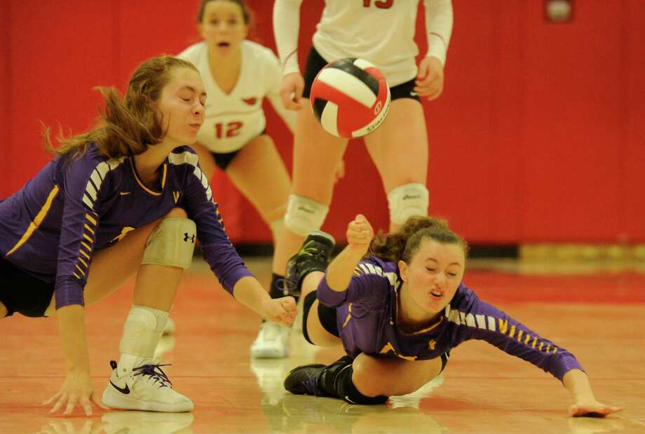 Westhill's Caroline Boyd (12) and Betsy Sachs (15) dive for the ball in an FCIAC girls volleyball game against Greenwich in Greenwich, Connecticut on Sept. 12, 2019. Greenwich defeated Westhill 3-1. Photo: Matthew Brown / Hearst Connecticut Media / Stamford Advocate