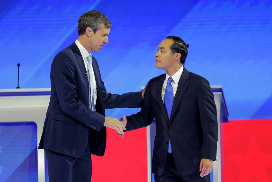 Democratic presidential candidates former U.S. Rep. Beto O'Rourke and former Housing Sec. Julian Castro welcome each other to the stage during the Democratic presidential debate inside Texas Southern University's Health & PE Arena in Houston, Thursday, Sept. 12, 2019. Photo: Elizabeth Conley, Staff Photographer / © 2019 Elizabeth Conley / Houston Chronicle