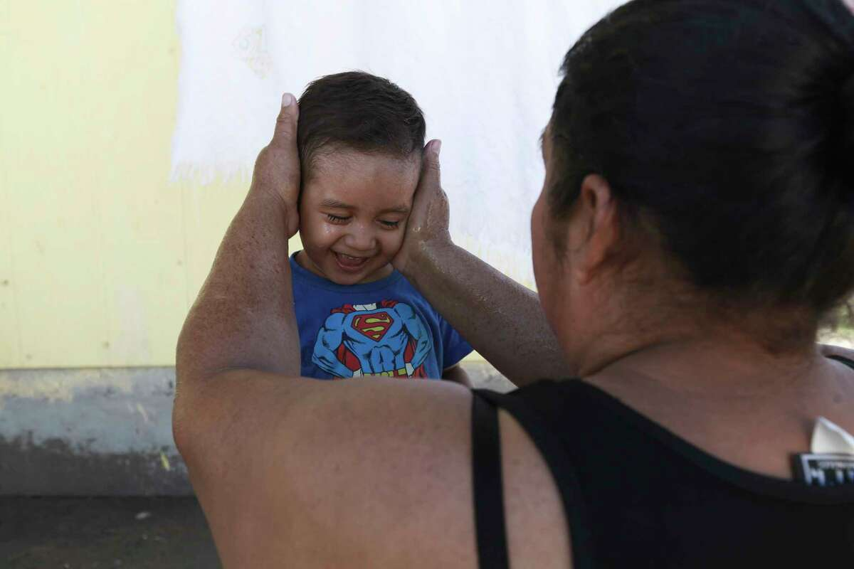 A migrant mother washes her son's face at the Pan de Vida shelter where they are living in Ciudad Juarez, Mexico, while waiting for a chance to request asylum in the United States, Thursday, Sept. 12, 2019. Mexican Foreign Secretary Marcelo Ebrard said Thursday that Mexico's government doesn't agree with an