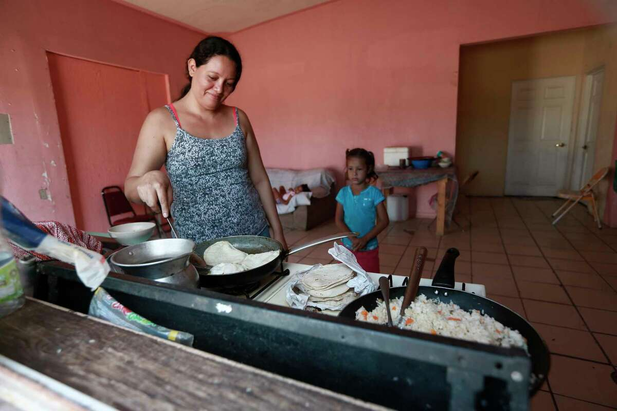 A Honduran migrant prepares tortillas and rice at the Pan de Vida shelter for migrants where she and her two daughters are living while waiting their turn to apply for asylum in the U.S. in Ciudad Juarez, Mexico, Thursday, Sept. 12, 2019. Mexican Foreign Secretary Marcelo Ebrard said Thursday that Mexico's government doesn't agree with an