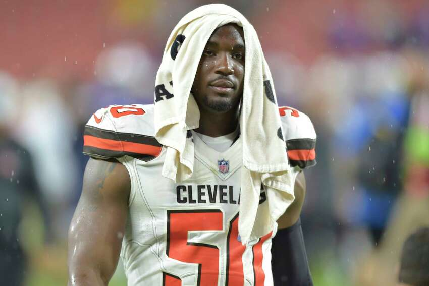 FILE - In this Aug. 17, 2018, file photo, Cleveland Browns defensive end Chris Smith (50) walks off the field after an NFL football preseason game against the Buffalo Bills, in Cleveland. Browns coach Freddie Kitchens said his team is a€œhurtinga€ for defensive end Chris Smith after his girlfriend was killed in an accident. Petara Cordero, who recently had a daughter with Smith, was struck by a car as she stood on the roadside Wednesday, Sept. 11, 2019. Smitha€™s car had blown a tire and the 26-year-old Cordero exited the vehicle when she was stuck by an oncoming car driven by a woman who admitted to police she had been drinking. (AP Photo/David Richard, File)