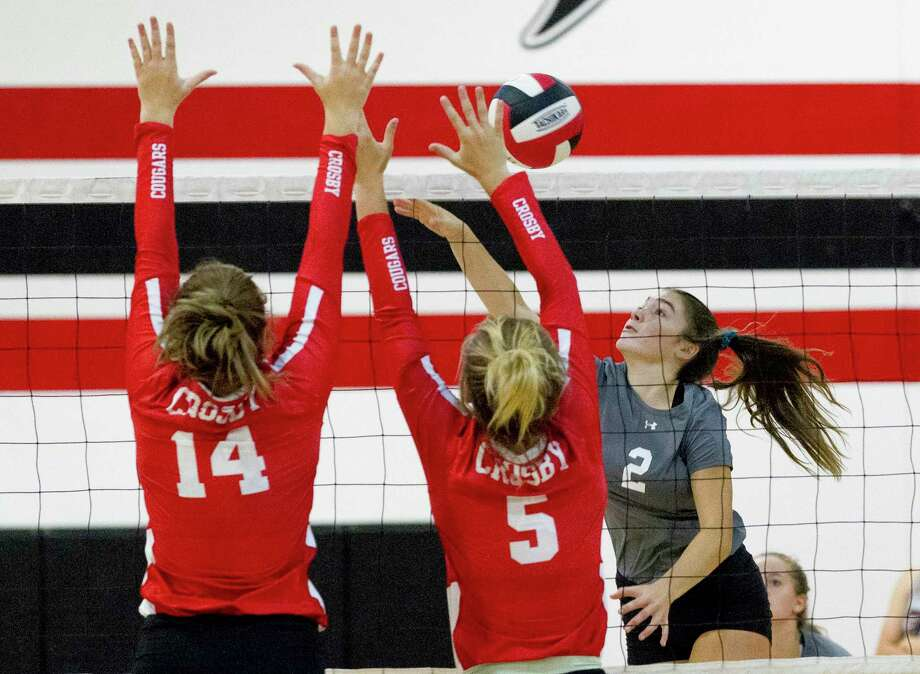 Magnolia outside hitter Kendall Boggan (2) gets a shot past the Crosby defense in the first set of a match during the Huffman Varsity Volleyball Tournament at Huffman High School, Thursday, Aug. 8, 2019, in Huffman. Photo: Jason Fochtman, Houston Chronicle / Staff Photographer / Houston Chronicle