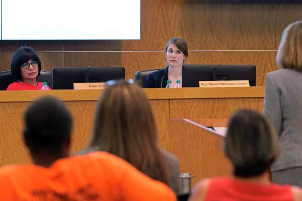 In this August file photo, Houston ISD Board President Diana Dávila, left, and Trustee Holly Maria Flynn Vilaseca, right, are shown during a school board meeting at Hattie Mae White Educational Support Center.