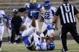 Lamarcus Simmons (10) of Chavez is sacked during the second quarter of a non-district football game between the Elkins Knights and the Chavez Lobos on Thursday, September 12, 2019 at Hall Stadium, Missouri City, TX.