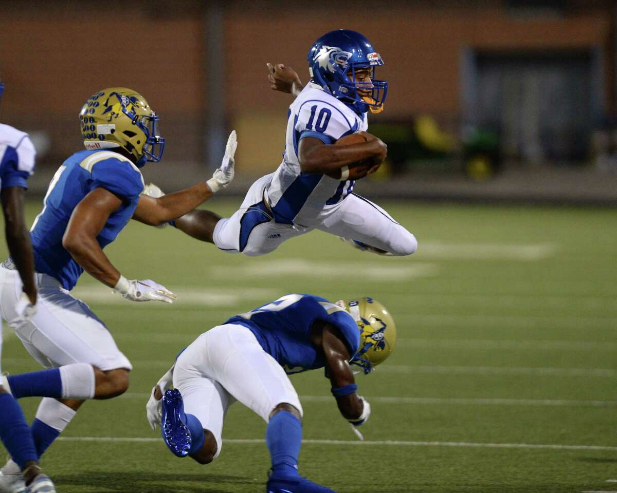 PHOTOS: Elkins vs. Chavez Javion Young (12) of Elkins gets under Lamarcus Simmons (10) on a quarterback keeper of Chavez for during the second quarter of a non-district football game between the Elkins Knights and the Chavez Lobos on Thursday, September 12, 2019 at Hall Stadium, Missouri City, TX.