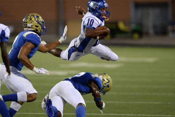Javion Young (12) of Elkins gets under Lamarcus Simmons (10) on a quarterback keeper of Chavez for during the second quarter of a non-district football game between the Elkins Knights and the Chavez Lobos on Thursday, September 12, 2019 at Hall Stadium, Missouri City, TX.