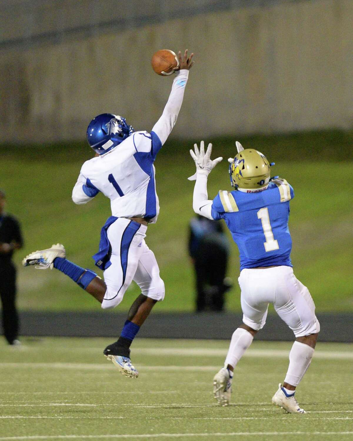 DeVaughn Wilson (1) of Chavez breaks up a pass intended for Jacory Lee (1) of Elkins during the second quarter of a non-district football game between the Elkins Knights and the Chavez Lobos on Thursday, September 12, 2019 at Hall Stadium, Missouri City, TX.