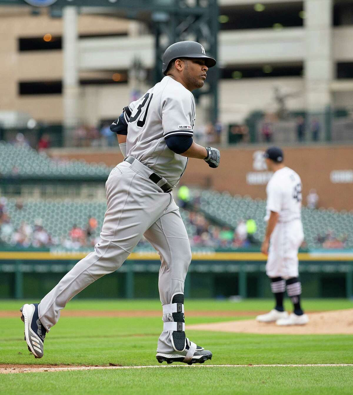 DETROIT, MI - SEPTEMBER 12: Edwin Encarnacion #30 of the New York Yankees rounds the bases on his two-run home run in the third inning of game one of a double header against the Detroit Tigers at Comerica Park on September 12, 2019 in Detroit, Michigan. (Photo by Leon Halip/Getty Images)