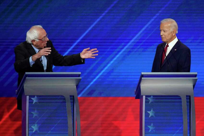 Sen. Bernie Sanders, I-Vt., left, gestures to former Vice President Joe Biden, Thursday, Sept. 12, 2019, during a Democratic presidential primary debate hosted by ABC at Texas Southern University in Houston. (AP Photo/David J. Phillip)