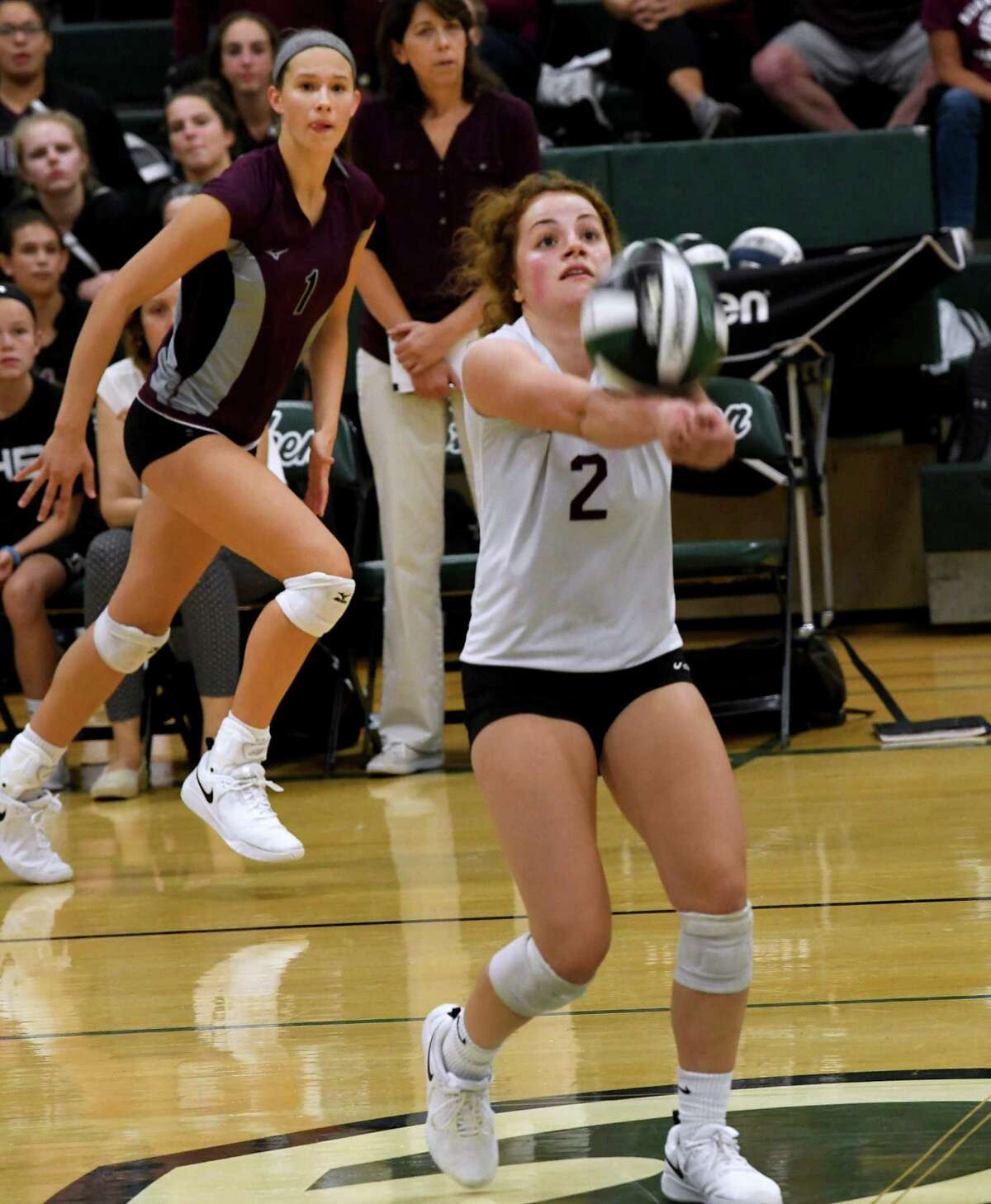 Burnt Hills' Sofia Pawlusik, #2, sets up the ball for Carlie Rzeszotarski, left, during a volleyball match against Shenendehowa on Thursday, Sept. 12, 2019 in Clifton Park, N.Y. (Lori Van Buren/Times Union)