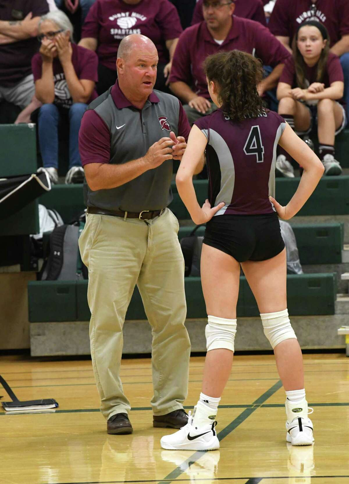Burnt Hills coach Gary Bynon talks to Claire Isaksen during a volleyball match against Shenendehowa on Thursday, Sept. 12, 2019 in Clifton Park, N.Y. (Lori Van Buren/Times Union)