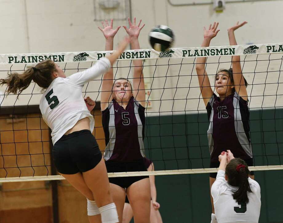 Shenendehowa's Annie Sala tries to get the ball past Burnt Hills's Morgan Bohlke, #5, and Callie Chevalier, #15, during a volleyball match on Thursday, Sept. 12, 2019 in Clifton Park, N.Y. (Lori Van Buren/Times Union) Photo: Lori Van Buren / 20047810A