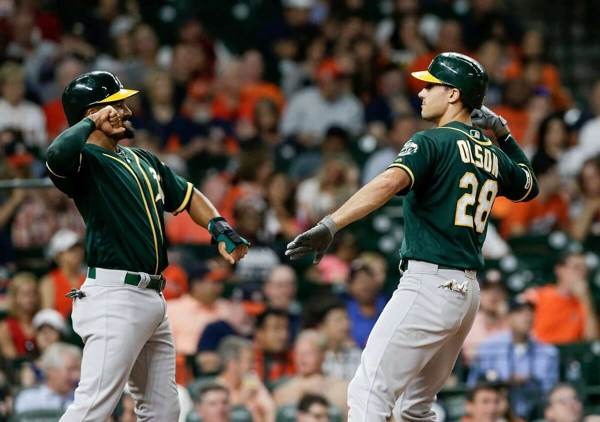 HOUSTON, TX - SEPTEMBER 12: Marcus Semien #10 of the Oakland Athletics congratulates Matt Olson #28 after a two run home run in the third inning against the Houston Astros at Minute Maid Park on September 12, 2019 in Houston, Texas. (Photo by Tim Warner/Getty Images)