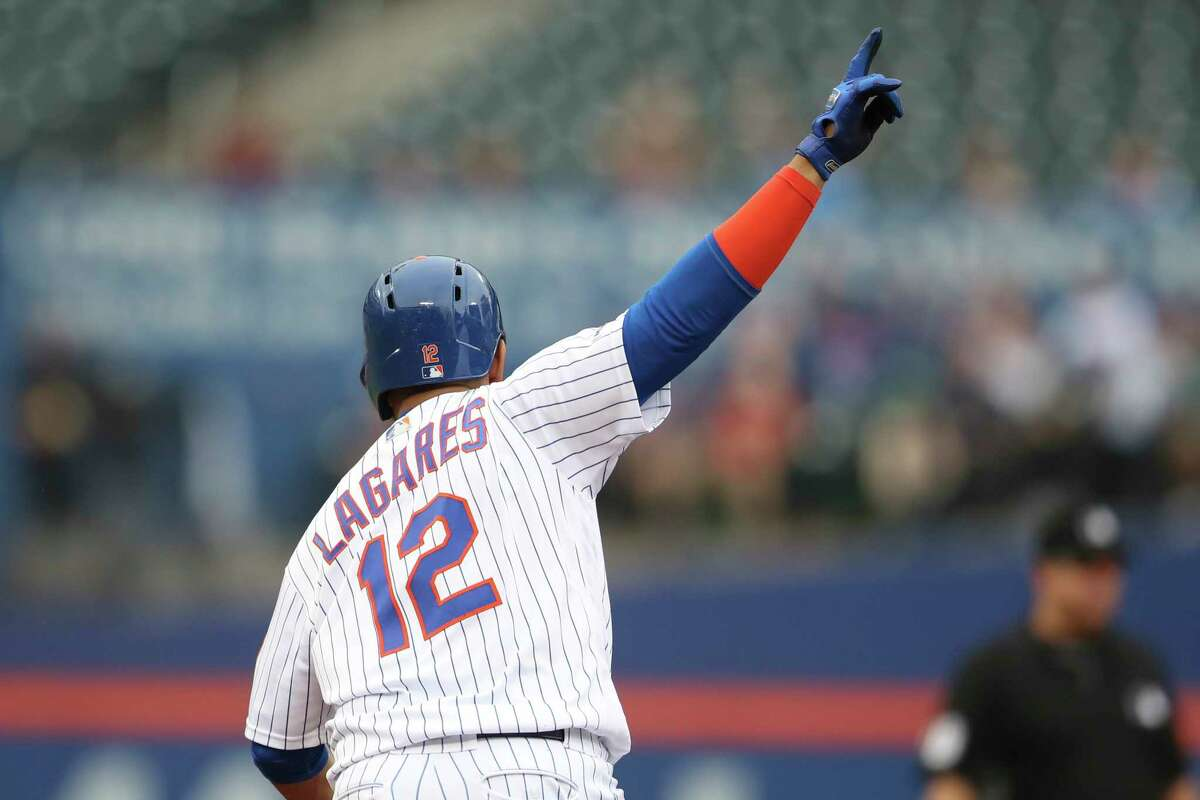 New York Mets' Juan Lagares runs the bases after hitting a two run home run during the fifth inning of a baseball game against the Arizona Diamondbacks, Thursday, Sept. 12, 2019, in New York. (AP Photo/Mary Altaffer)