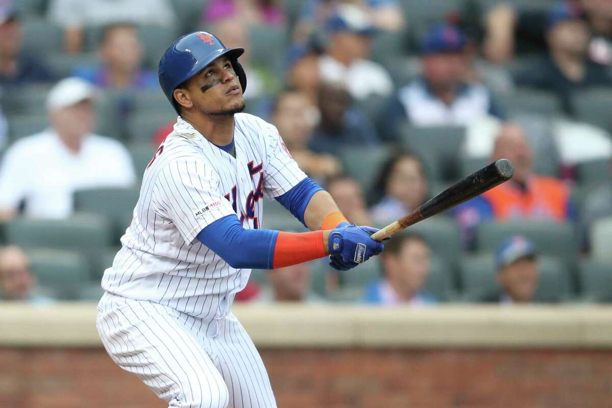 New York Mets' Juan Lagares watches the ball after hitting a two run home run during the fifth inning of a baseball game against the Arizona Diamondbacks, Thursday, Sept. 12, 2019, in New York. (AP Photo/Mary Altaffer)