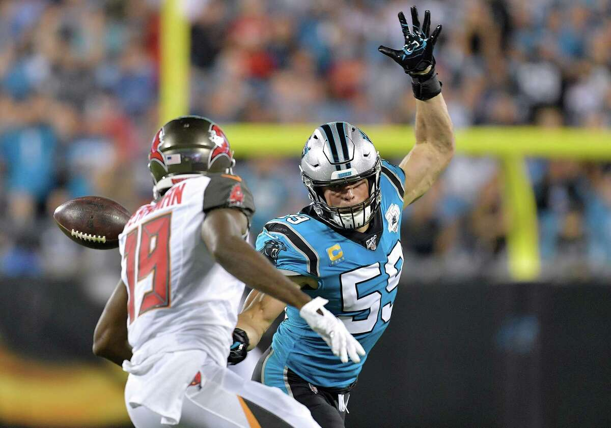 CHARLOTTE, NORTH CAROLINA - SEPTEMBER 12: Luke Kuechly #59 of the Carolina Panthers breaks up a pass intended for Breshad Perriman #19 of the Tampa Bay Buccaneers during the third quarter of their game at Bank of America Stadium on September 12, 2019 in Charlotte, North Carolina. (Photo by Grant Halverson/Getty Images)