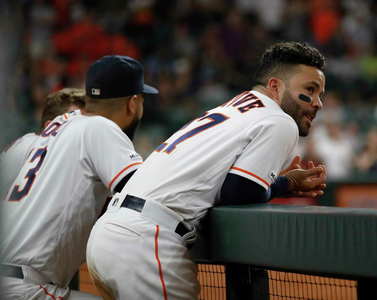 Houston Astros Jose Altuve (27) watches Kyle Tucker's at bat from the top of the dugout in the eighth inning of a MLB baseball game at Minute Maid Park, Thursday, Sept. 12, 2019, in Houston.