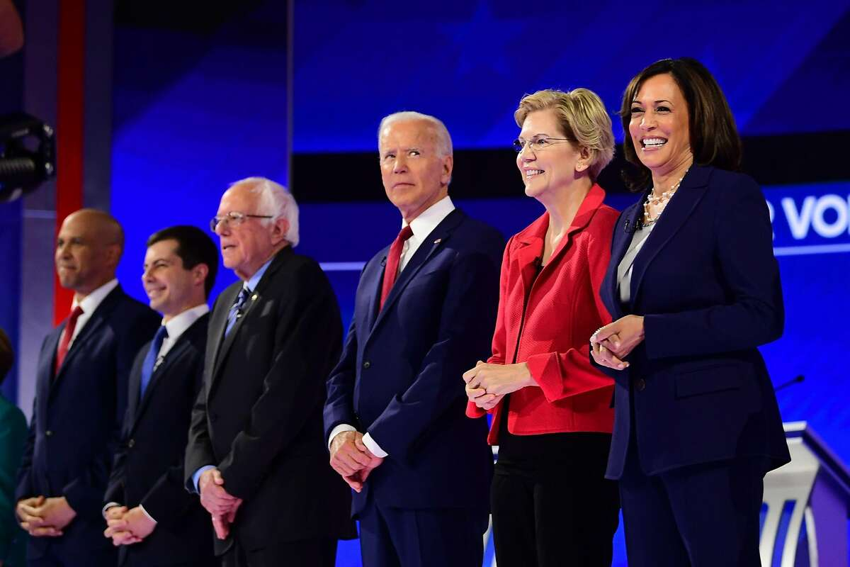 Democratic presidential hopefuls (L-R) Senator of New Jersey Cory Booker, Mayor of South Bend, Indiana, Pete Buttigieg, Senator of Vermont Bernie Sanders, Former Vice President Joe Biden, Senator of Massachusetts Elizabeth Warren and Senator of California Kamala Harris arrive onstage for the third Democratic primary debate of the 2020 presidential campaign season hosted by ABC News in partnership with Univision at Texas Southern University in Houston, Texas on September 12, 2019. (Photo by Frederic J. BROWN / AFP)FREDERIC J. BROWN/AFP/Getty Images
