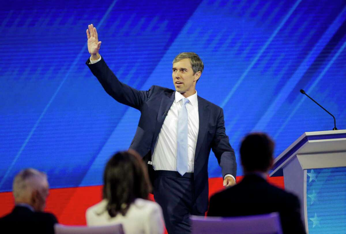 Democratic presidential candidate former U.S. Rep. Beto O'Rourke is welcomed to the stage during the Democratic presidential debate inside Texas Southern University's Health & PE Arena in Houston, Thursday, Sept. 12, 2019.