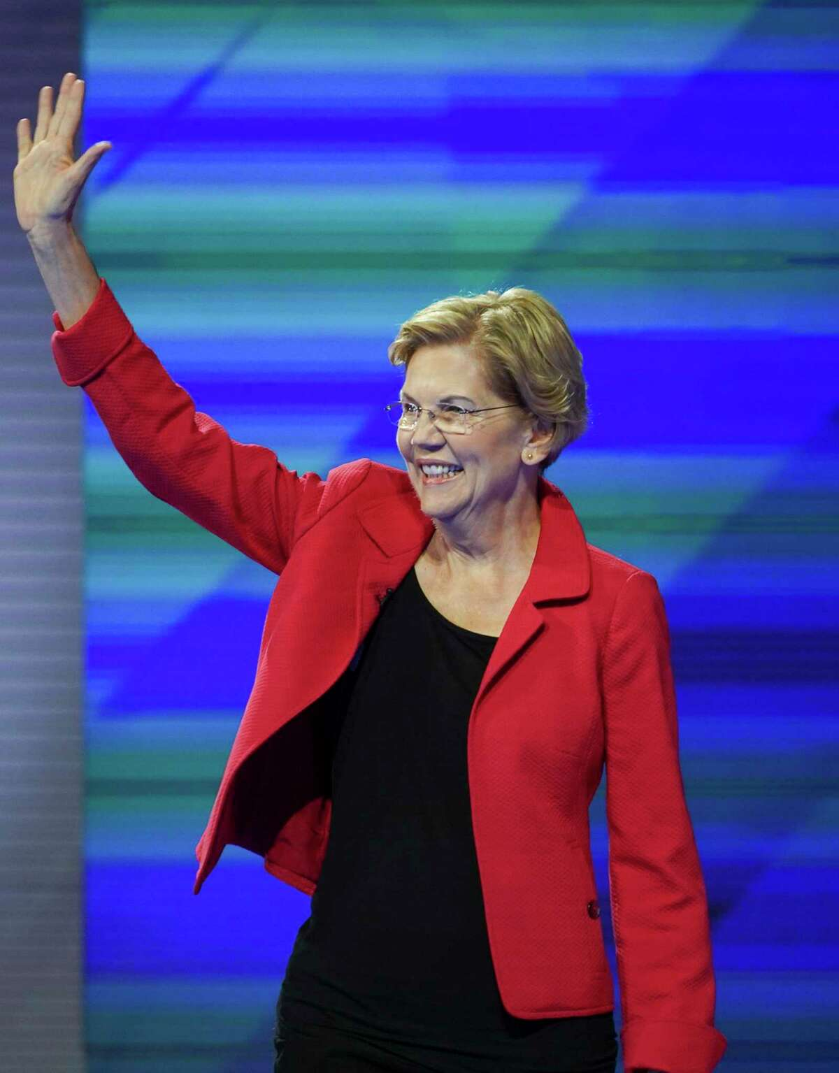 Democratic presidential candidate Sen. Elizabeth Warren, D-Mass., takes the stage for the Democratic Debate at Texas Southern University's Health & Physical Education Center Thursday, Sept. 12, 2019, in Houston.