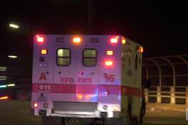 A Houston police officer is rushed to Memorial Hermann Hospital in the Texas Medical Center after being shot while on duty Thursday, Sept. 12, 2019, just miles away from the Democratic presidential debate at Texas Southern University.